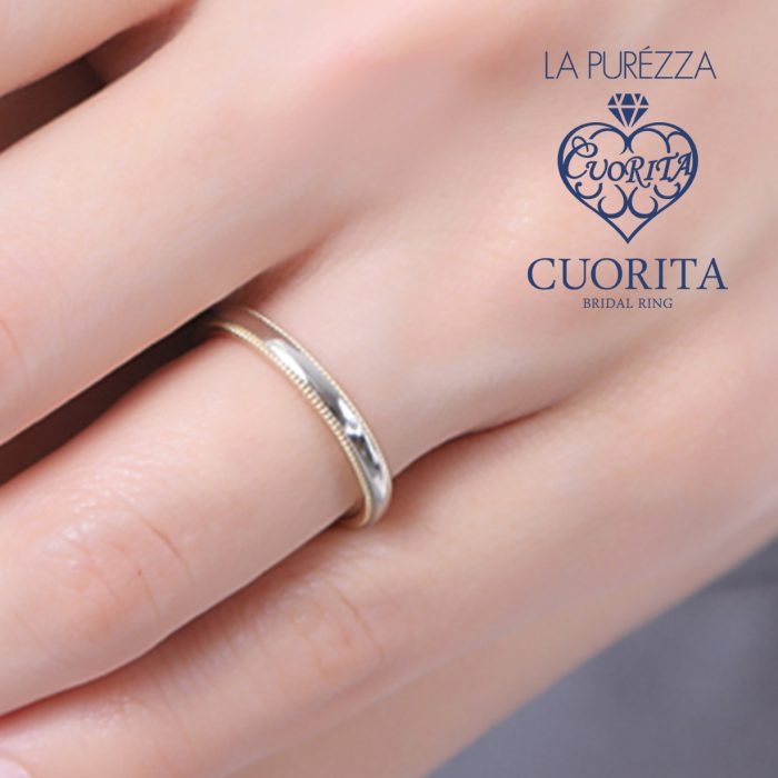 上下に施されたミル打ちが上品な印象を与える結婚指輪です
